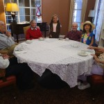Residents enjoying the cookies and company of the girl scouts