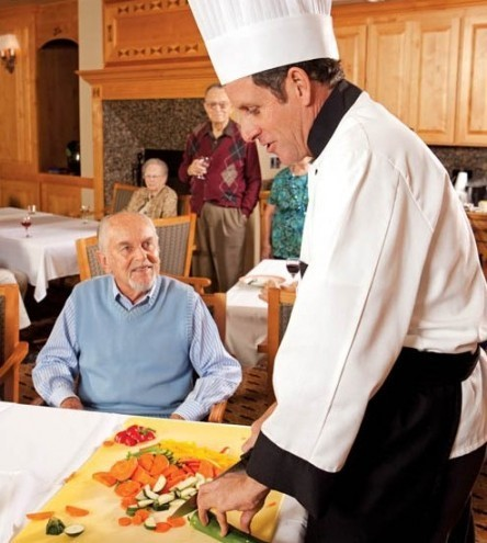 Chef giving cooking class for residents