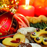 Christmas atmosphere - candle, sweets and Christmas decorations