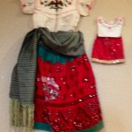 One of our residents who spent her childhood in Mexico shared a traditional dress she wore as a child along with a matching outfit for her doll. The 75 year old garment is handmade with incredible detail that is hard to find today.