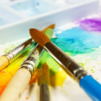 colorful abstract watercolor painting with brushes