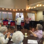Fountains Resident Cornelia Schacht enjoying the band and dancing a polka.