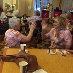 Ivy and Cornelia enjoying the music and hand games.