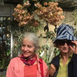 Marge Osborn-O'Don and Liz Rose in the butterfly exhibit, look at those orchids!