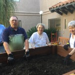 Jean, Danny, Mari and Mimi preparing the soil for the plants.