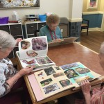 Ladies from The Gardens enjoying the scrapbooks