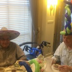 Byron and Charlie showing off their fun sombrero and balloon hat!