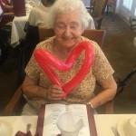 Ruth loves her red heart balloon!