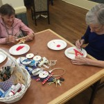 Ladies painting their stars a patriotic red!