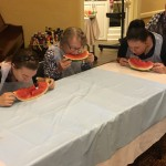 Residents and staff chowing down on watermelon.