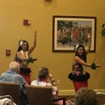 Hula dancers performing in The Inn's lobby.