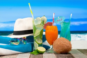 Fresh cocktails on the beach. Mojito and orang juice. Summer Vacation on the seashore.
