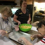 Residents forming the popcorn balls.