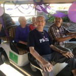 Residents that have a harder time walking had golf carts to help them participate!