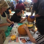 The sales girls getting started on their silly pumpkin.