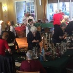 2017 Holiday Fund Jewelry Sale, with shoppers filling the lobby.