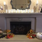 Our mantel decorating looking spooky with art that resident created!