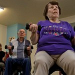 Dee Cohen, 93, uses weights in a fitness class at The Fountains. Photo Credit: Arizona Daily Star