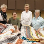 Alice, Jeannie, Margaret and Norman display their colorful mats.
