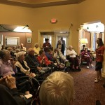 A packed lobby listening to April's presentation.