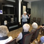 Sally Poile welcoming residents to The Eyes Have It.