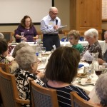 Cantor Cohen and Bernie at our Passover Seder, blessing the first cup of wine.