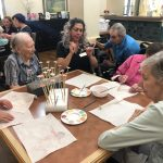 Gardens residents learning how to paint the pieces.