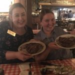 Abby and Valerie showing off their steaks.
