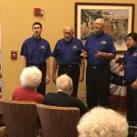 The Tucson Barbershop Experience performing to a packed lobby!