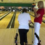 Marianne cheering Betty Jo on as she bowled a strike!