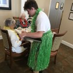Tyler dressed in the grass skirt was a huge hit with the residents!
