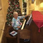 Resident Charlotte playing Christmas carols as residents were getting their walkers and wheelchairs decorated!