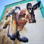 The 45-foot wide by 75-foot high mural combines the mythical jackalope with one of Tucson's favorite basketball dads, Bill Walton.