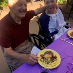 Malcolm and resident Nan enjoying the delicious omelets that were made